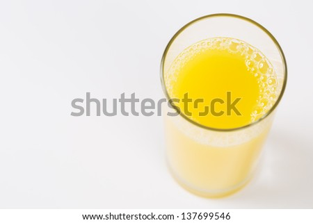 Look above on glass of bubble orange juice - stock photo