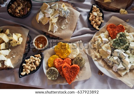 Look from above at table with cheese and other snacks