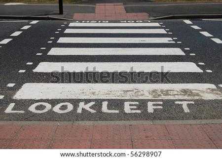 Look left UK pedestrian zebra crossing - stock photo