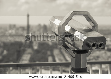 Look-out binoculars with view over the Eiffel Tower in Paris, France. - stock photo