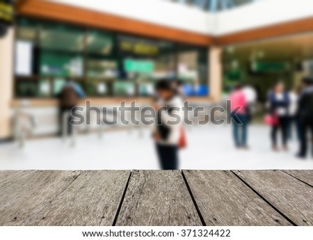 Look out from the table, blur image of counter in hospital as background. - stock photo