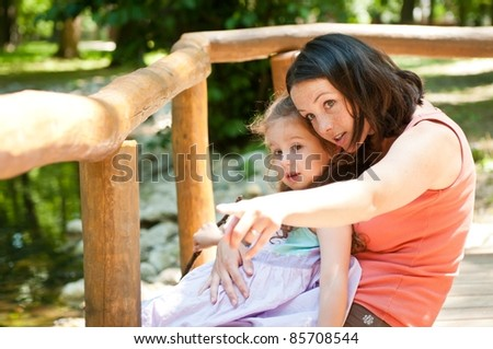 Look there - mother with child - stock photo