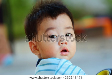 looked asian baby, close-up - stock photo
