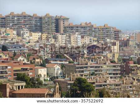 Looking across at hillside development of houses and apartments in Barcelona Spain - stock photo