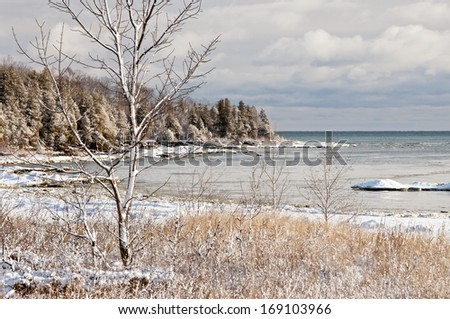 Looking across Newport Bay toward Lynd Point at Newport State Park in Door County, Wisconsin. - stock photo