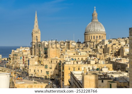 Looking across the rooftops of Valletta towards the St Johns Cathedral - stock photo