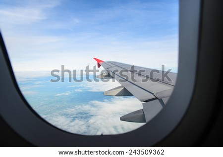 looking at aircraft wing view from windows - stock photo