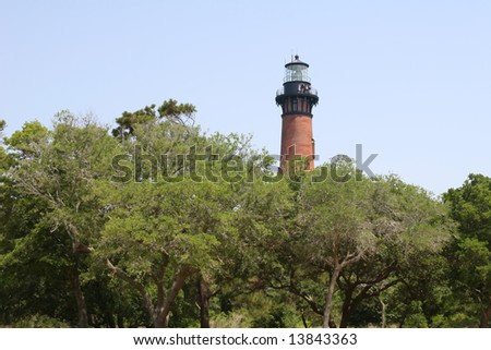 looking at Currituck Beach Lighthouse with trees in the foreground