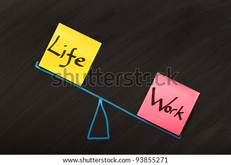 Looking at the balance between life and work - stock photo