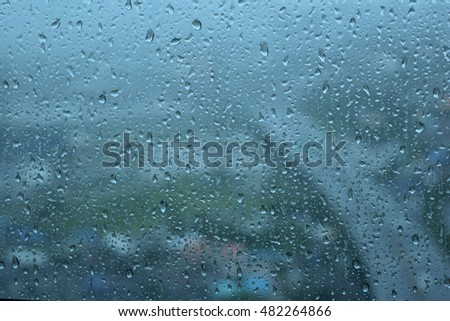 Looking at the beautiful rain drops  out side the window abstract art background