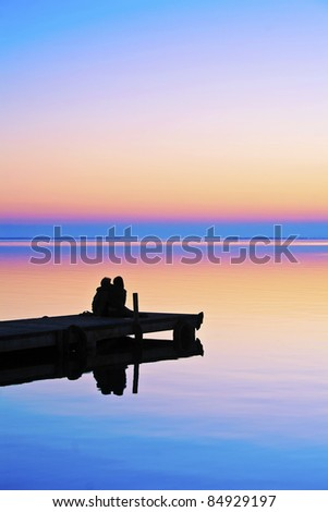 looking at the lake hugging - stock photo