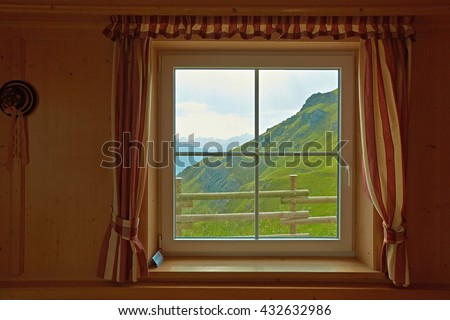 Looking at the rain from the window of a mountain hut