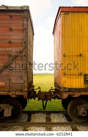 Looking between two old train cars - stock photo
