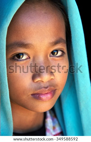 Looking Cambodian girl. The girl looks into the camera lens, is very beautiful and deep eyes. Pupils reflect photographer: November 29, 2009: Cambodia, Muslim village - stock photo