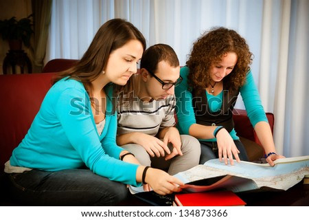 Looking directions on the map - stock photo