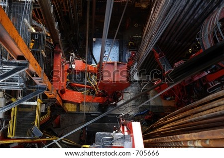 Looking down at drill floor from derrick - stock photo