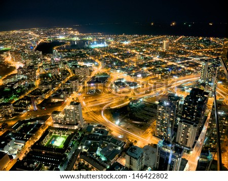 looking down on melbourne at night including albert park lake - stock photo