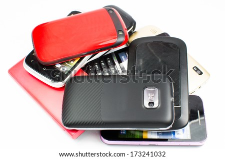 Looking down onto a pile of mobile phones  - stock photo