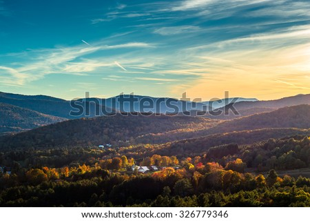 Looking down over the south end of Woodstock Vermont during the peak of fall foliage season - stock photo