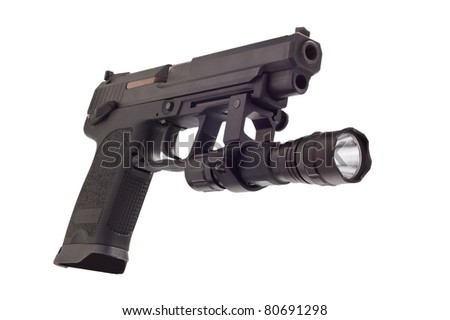 Looking down the barrel of a large 9mm automatic pistol with flashlight - stock photo