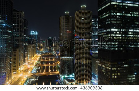 Looking down the Chicago River at night in Chicago, Illinois  . - stock photo