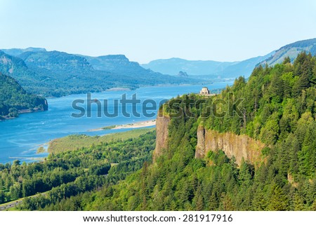 Looking down the Columbia River Gorge with Vista House visible on the hill - stock photo