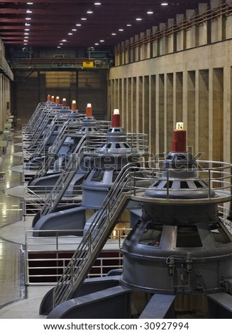 Looking down the line of HydroElectric Generators - stock photo