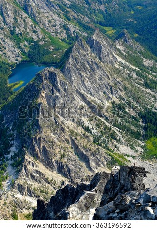 Looking Down the North Ridge of Mt. Stuart From the Summit.  The Alpine Lakes Wilderness, Cascade Mountains, Washington - stock photo