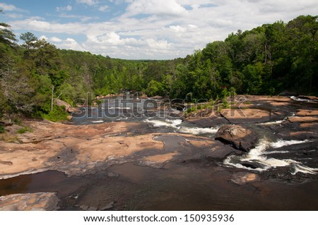 Looking downstream of High Falls on the Towaliga River in Georgia. - stock photo