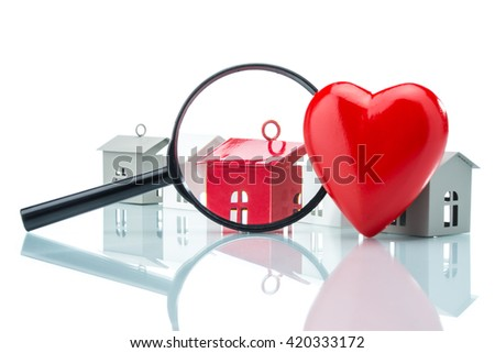 Looking for loving family, house model with magnifying on white background - stock photo