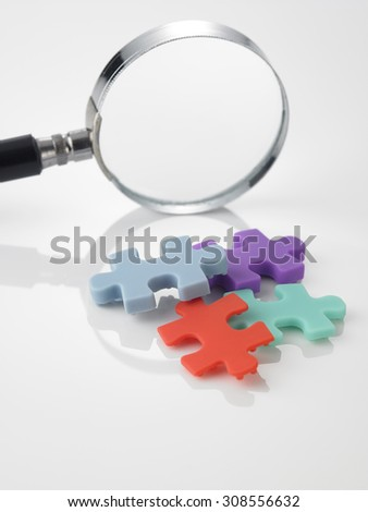 looking for the match of jigsaw puzzle - stock photo