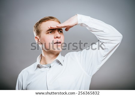 looking forward with big expectations - business man on white background - stock photo