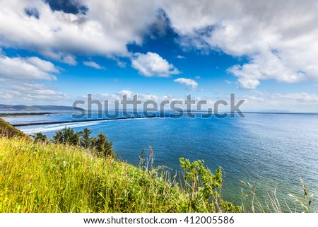 Looking from Washington to Oregon over the mouth of the Columbia River - stock photo