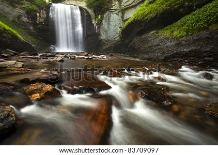 Looking Glass Falls - Pisgah National Forest.  This waterfall is found along the Blue Ridge parkway in North Carolina - stock photo