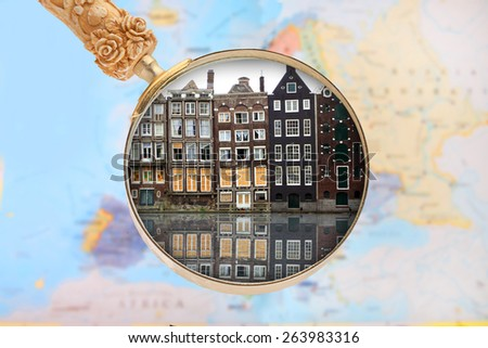 Looking in on Amsterdam, Holland or Netherlands with blurred European map in the background - stock photo