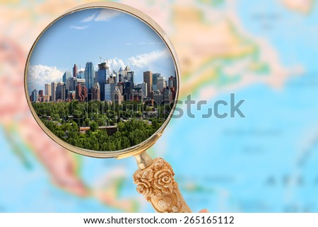 Looking in on Calgary Alberta with blurred map of North America in the background - stock photo