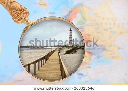 Looking in on Praia Barra, Costa Nova, Portugal with European map in the background - stock photo