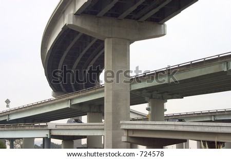 Looking like cement spaghetti, cars are routed through a complex of freeway overpasses.