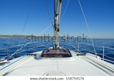 looking off the bow of a sailboat at sea - stock photo
