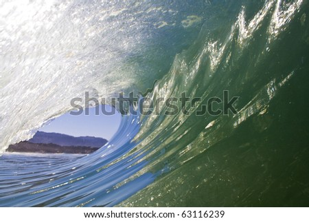 Looking out of a beautiful curling wave - stock photo