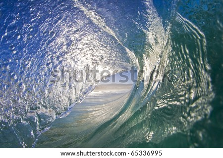 Looking out of a beautiful ocean wave. - stock photo