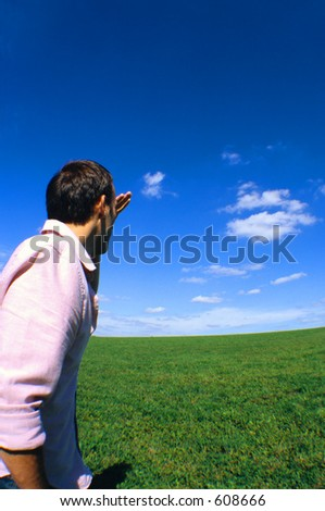 Looking out onto a field of grass. - stock photo