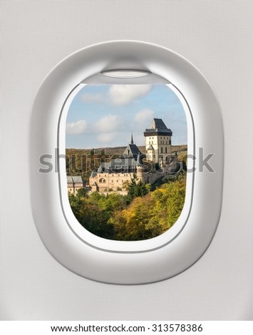 Looking out the window of a plane to the Karlstejn castle in Czech Republic