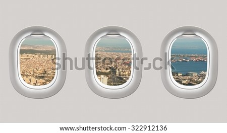 Looking out the windows of a plane to the city of Istanbul, Turkey - stock photo