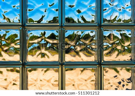 Looking outdoors through a glass block window with whimsical distortions