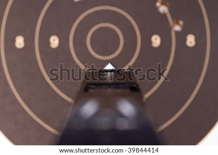 Looking over sights of a 9mm automatic pistol - stock photo