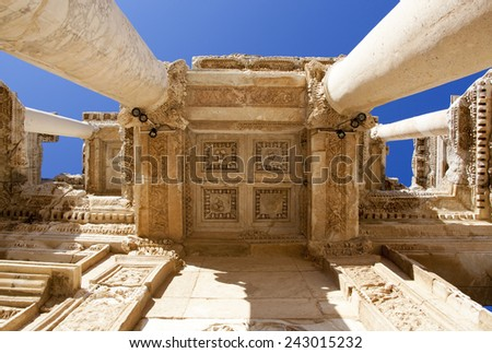 Looking straight up at the entrance to Celsus Library in ancient Greek city of Ephesus (Turkey). - stock photo