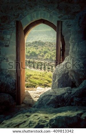Looking through a gate in a beautiful landscape