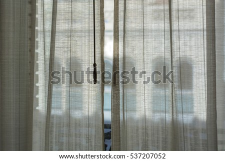 looking through curtains