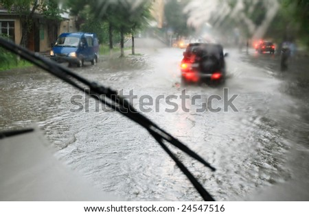looking through the car window in the rain - stock photo